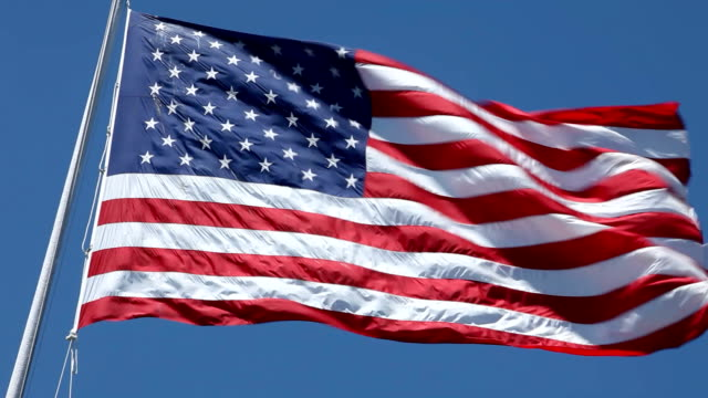 stockvideo's en b-roll-footage met american flag waving in the wind, hd 1080p - amerikaanse vlag