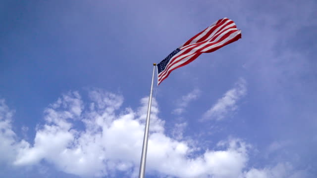 american flag waving in the wind on nice day - amicizia tra donne video stock e b–roll