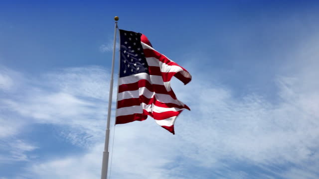 usa american flag waving in the wind - flag blowing in the wind stock videos & royalty-free footage
