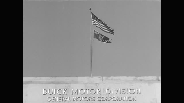 vídeos de stock e filmes b-roll de ms tu american flag waving on top of general motors building / united states - general motors