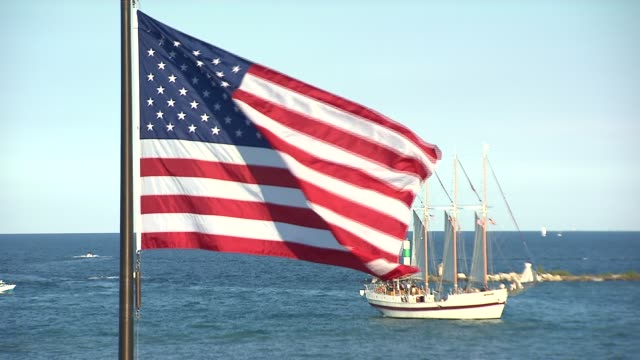 american flag with lake michigan and boat in background near navy pier on july 4 2014 in chicago illinois - lake michigan stock videos & royalty-free footage