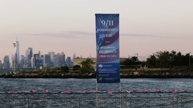 american flags and a 9/11 community vigil banner hang at the american veterans memorial pier on september 11, 2020 in bay ridge, brooklyn, new york... - biological process stock videos & royalty-free footage