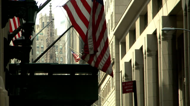 american flags are displayed from buildings in downtown manhattan. - manhattan video stock e b–roll