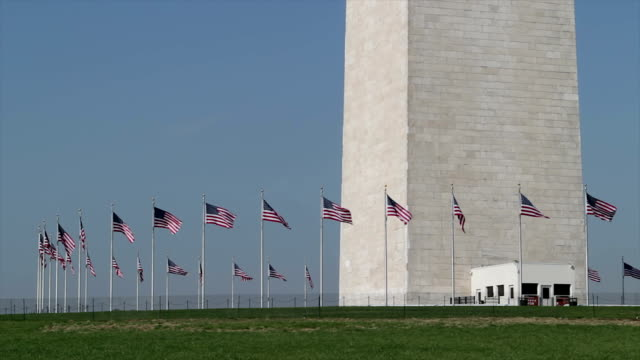 american flags at the washington monument close up - washington monument washington dc stock videos & royalty-free footage