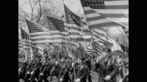 vidéos et rushes de american flags carried by members of the american legion, passing central park - 1949