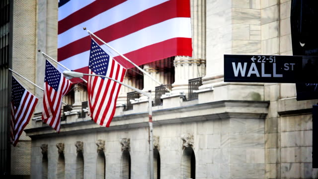 american flags hang outside the new york stock exchange. - new york stock exchange stock videos and b-roll footage