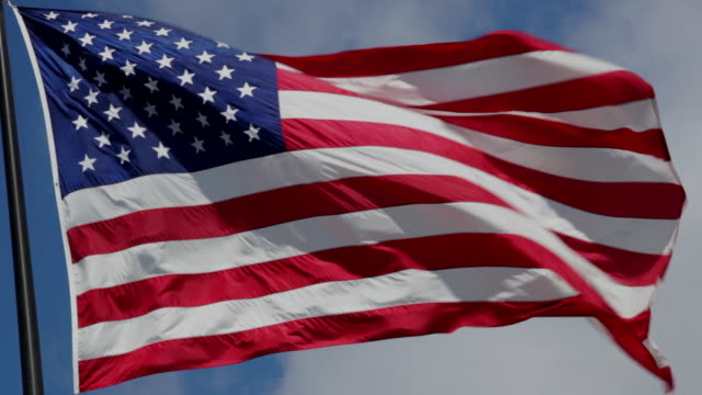 american flags in the breeze - stars and stripes stock videos & royalty-free footage