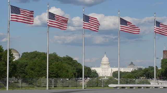 american flags in washington as museums reopen, on may 14, 2021 in washington, d.c., u.s. - flag stock videos & royalty-free footage