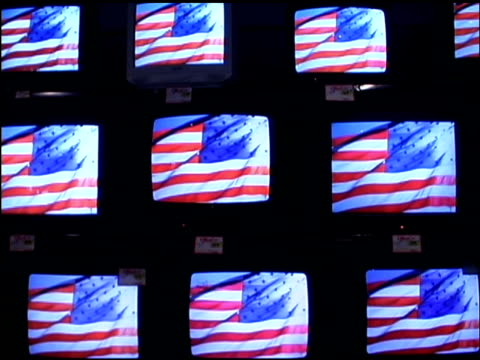 vídeos de stock, filmes e b-roll de american flags on televisions - medium group of objects