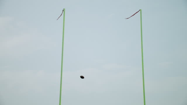ws, la, american football ball flying over goal, staten island, new york, usa - football goal post stock videos and b-roll footage