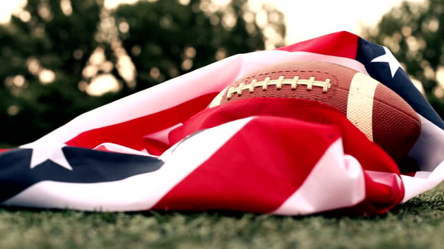 American football ball with us national flag