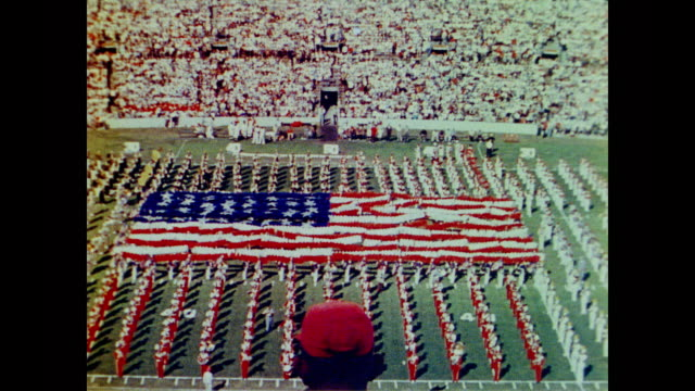 1958 american football field with patriotic half-time show - marching band stock videos and b-roll footage
