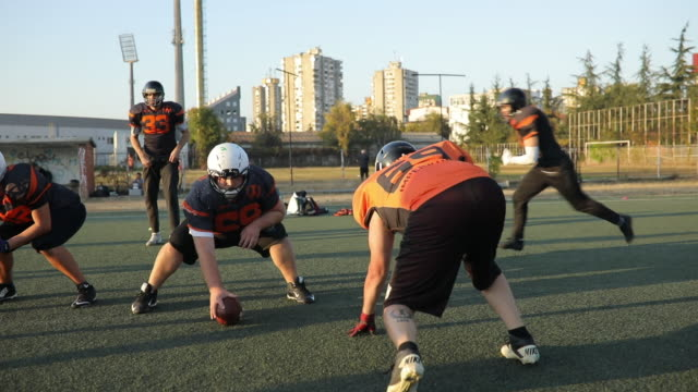 American football game in motion