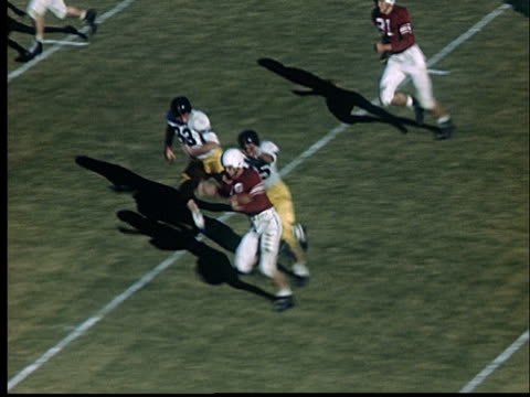 stockvideo's en b-roll-footage met composite, american football game in stadium, 1950's, oklahoma, usa - prelinger archief
