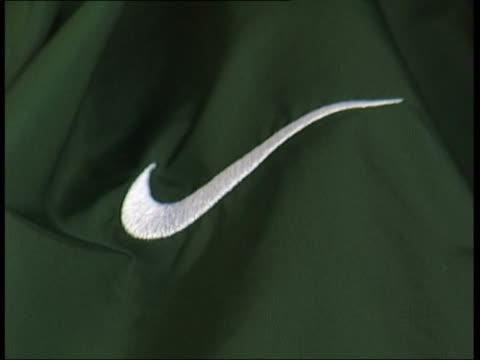 american football match at oregon university sports commentator speaking into microphone in prematch buildup sot / closeup nike logo on commentator's... - nike designer label stock videos and b-roll footage