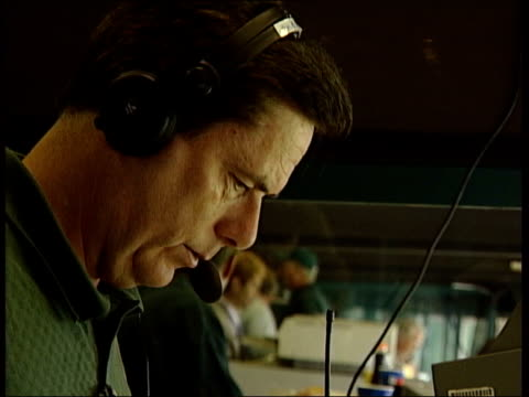 american football match at oregon university usa oregon eugene ext pepsi branded paper cups laid out on table / american football commentator wearing... - nike designer label stock videos and b-roll footage