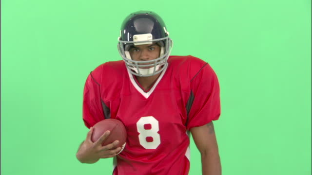 ms, american football player catching ball in studio, portrait - neenah stock videos & royalty-free footage