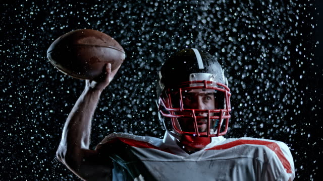 SPEED RAMP American football player in white jersey throwing the ball on a black background