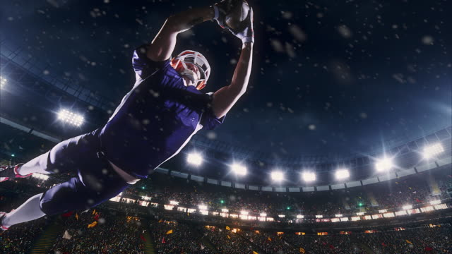 american football player jumps with a ball - football goal post stock videos and b-roll footage