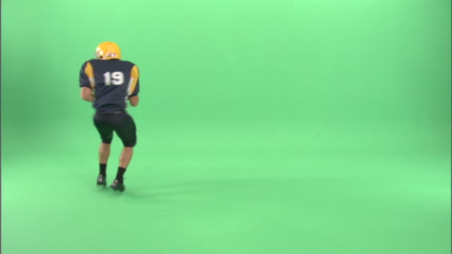 ws, american football player running in studio - neenah stock videos & royalty-free footage