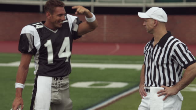 SLO MO, MS, American football player talking to referee in field, Staten Island, New York, USA