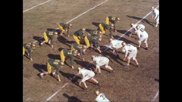 WS PAN HA American football players at line of scrimmage / United States