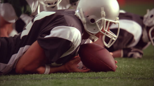 SLO MO, CU, American football players in action, Staten Island, New York, USA