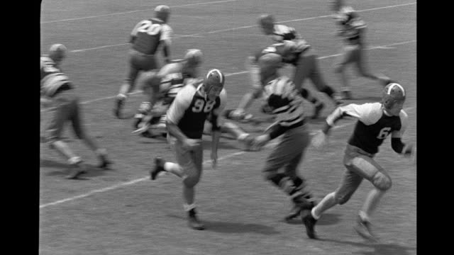 American football players line up and run play American football game on January 01 1942