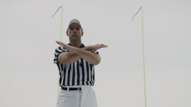 MS, LA, American football referee in field, ball flying over goal in background, Staten Island, New York, USA