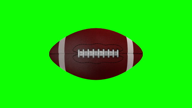 vídeos de stock e filmes b-roll de american football rotating over a chroma key background - football
