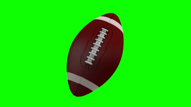 american football rotating over a chroma key background - single object stock videos & royalty-free footage