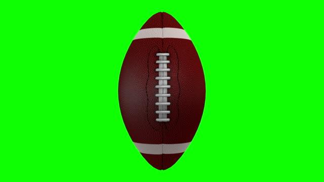 vídeos de stock e filmes b-roll de american football rotating over a chroma key background - bola de futebol americano bola