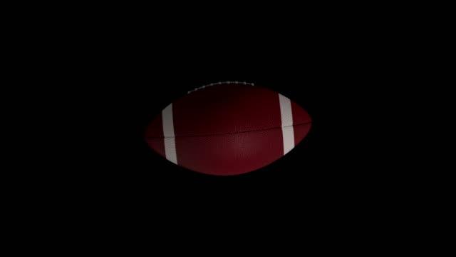 American footballl rotating loop isolated with luma matte