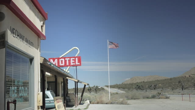 ws american gas station on road, looks like desert or country side with amercian flag / palmdale, ca, united states  - palmdale stock videos and b-roll footage