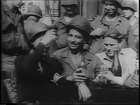 american gi on street corner in front of american bar, directing traffic / interior of bar, woman serving a long line of soldiers / close-up of woman... - directing stock videos & royalty-free footage