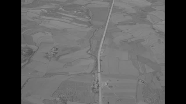 american gis wipe down spotlight / truck crosses partially damaged bridge, hot air balloon in distant sky / gis wipe down spotlight in bed of army... - koreakriget bildbanksvideor och videomaterial från bakom kulisserna
