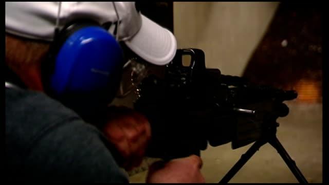 int man firing semiautomatic rifle at target - rifle stock videos & royalty-free footage