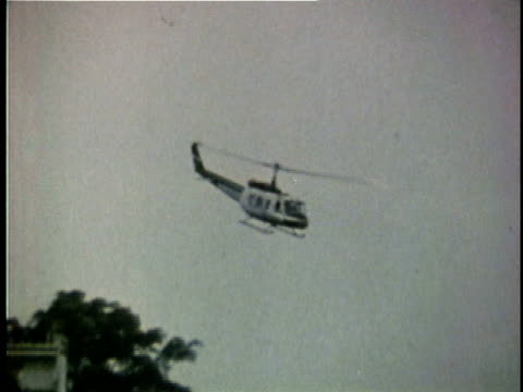 american helicopter in flight over city during the fall of saigon / south vietnam - 1975 stock videos & royalty-free footage