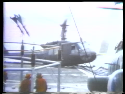 american helicopters crash on and near the decks of carriers in 1975. - (war or terrorism or election or government or illness or news event or speech or politics or politician or conflict or military or extreme weather or business or economy) and not usa stock videos & royalty-free footage