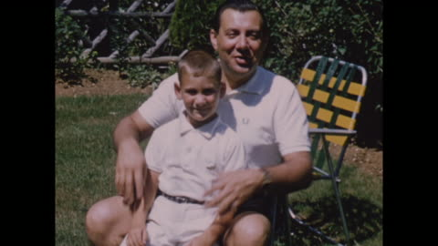 vidéos et rushes de american home movie footage circa 1950 of a father and son posing for the camera. - film d'amateur