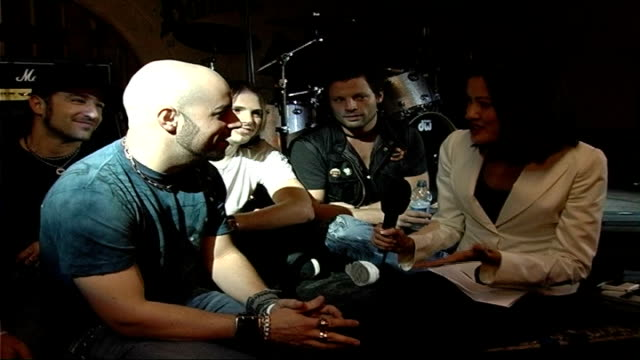american idol competitor plays london show england london int chris daughtry interview sot as sits with rest of 'daughtry' band on successful year - american idol stock videos and b-roll footage