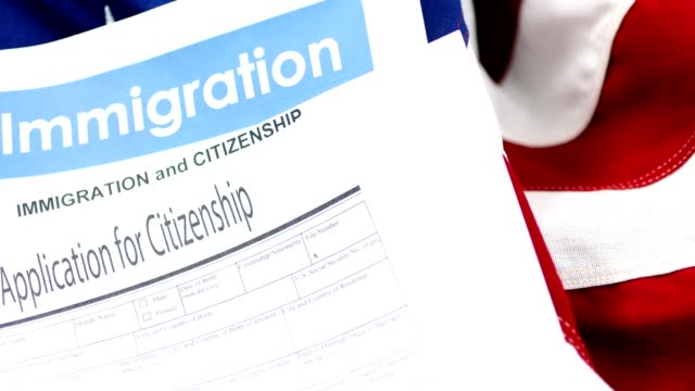 American immigration, citizenship forms with USA flag.