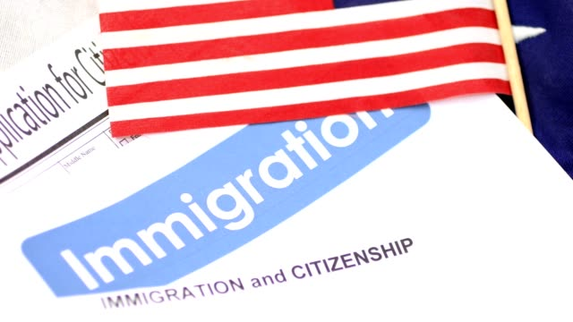 american immigration, citizenship forms with usa flag. - emigration and immigration stock videos & royalty-free footage