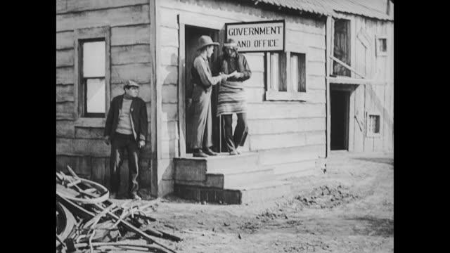 1922 american indian is cheated by businessman - 証書点の映像素材/bロール