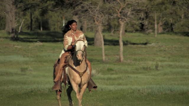 MS, TS, American Indian man riding paint horse, San Juan Mountains, Colorado, USA