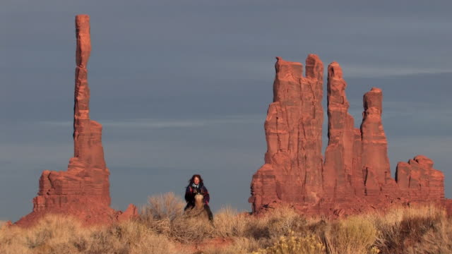 ms, american indian woman riding horse in monument valley navajo tribal park, utah, usa - monument valley stock videos & royalty-free footage