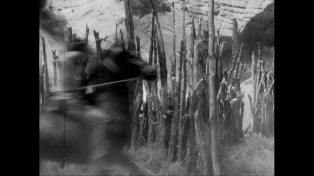 ws american indians pushing burning cart during fight / united states - espansione verso l'ovest video stock e b–roll