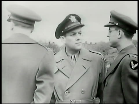 american jazz musician glenn miller standing outside in uniform coat hat w/ two officers all looking miller turning talking w/ other officers wwii... - 1904 stock videos & royalty-free footage