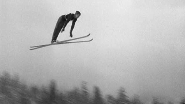 american jumping record is set by sverre kongsgaard of norway 290 feet on olympian hill / spectators watching ski jumpers / ski jumpers flying... - ski jumping stock videos and b-roll footage