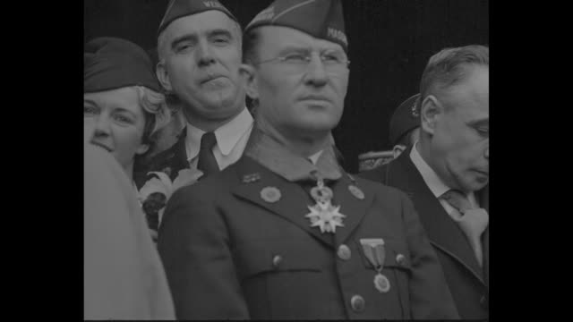 "american legionnaires march on paris street, bearing us and legion flags; vo applause from watching crowds / banner in parade ""welcome legionnaires""... - 1930 video stock e b–roll"